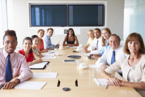 Point Of View Shot Of Businesspeople Around Boardroom Table